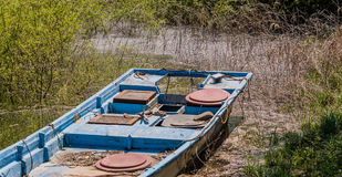Closeup of blue fishing boat in marsh Royalty Free Stock Images