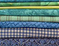 Closeup of Blue and Green Fabrics Stacked Horizontally Stock Photography