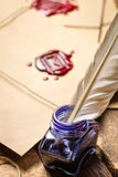 Closeup of blue ink and vintage envelope royalty free stock photography