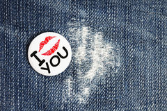 Closeup of blue jeans with badge Royalty Free Stock Photos