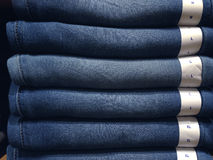 Closeup of blue jeans in a shop Royalty Free Stock Photography