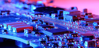 Closeup blue microcontroller board. With red and blue light Royalty Free Stock Photography