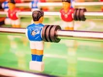 Closeup player of  football table game. Closeup blue player of a football table game Royalty Free Stock Images