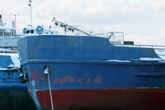 Closeup of blue and red prow of ship stock photos