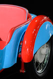 Closeup with blue red retro car. Vertical background with part o Royalty Free Stock Images