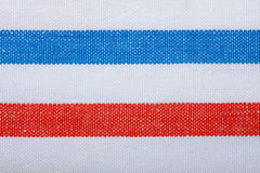 Closeup of blue red white striped textile as background or texture. Closeup of blue red white horizontal striped fabric textile as background texture or pattern Stock Photo