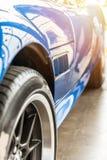 Closeup on a blue sport car Stock Image