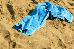 Closeup of blue towel on a sandy beach. Relax. Royalty Free Stock Images