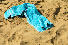 Closeup of blue towel on a sandy beach. Relax. Stock Photography