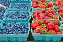 Closeup of Blueberries and Strawberries in boxes Royalty Free Stock Images