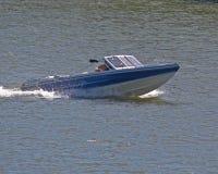 Closeup of Boat. Man crusing on lake enjoying a beautiful day Royalty Free Stock Photography