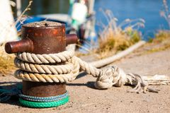 Closeup of boat cleat on a dock Royalty Free Stock Photography