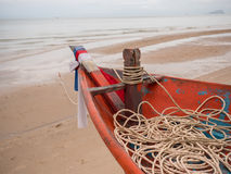 Closeup of boat head of squid fishing boat with rope on the beach in the cloudy morning day. At south of Thailand Royalty Free Stock Photography