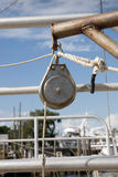 Closeup of Boat Pulley. Ships rigging block and tackle fixed pulley closeup with ropes Stock Images