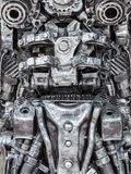 Closeup Body of metallic robot made from auto parts with machine. Ry gears bolts and nuts stock image