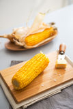 Closeup on boiled corn and butter on cutting board Stock Photos