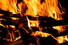 Closeup details of bonfire. Background of fire flames and wood Royalty Free Stock Photos