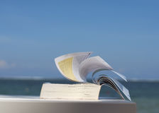 Closeup of a book on beach Stock Image