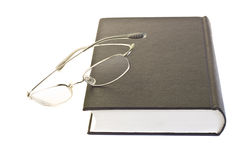 Closeup of book and glasses Royalty Free Stock Photography