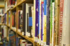 Closeup of Books on a Bookshelf stock photos