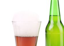Closeup of bottle and glass with beer. Stock Photos