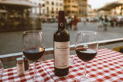 Closeup of bottle red wine Sant Alfonso Chianti Classico and glasses on table. Florence, Italy - June 24, 2018: Closeup of bottle red wine Sant Alfonso Chianti royalty free stock photos