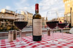 Closeup of bottle red wine Sant Alfonso Chianti Classico and glasses on table stock photos