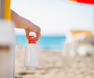 Closeup on bottle of sun block creme in hand Royalty Free Stock Photography