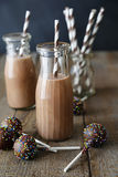 Closeup of bottles chocolate milk and cake pops Stock Image