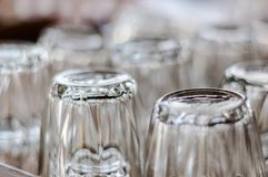 Closeup at bottom of upside down drinking glasses royalty free stock images