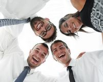 Closeup.bottom view.successful business people. With arms around each other`s shoulders stock photo