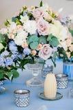 Closeup bouquet oflowers rose delphinium wedding. Closeup of a bouquet of flowers rose and delphinium wedding and candles Stock Photos