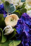 Closeup of bouquet of white and blue spring flowers Stock Photography