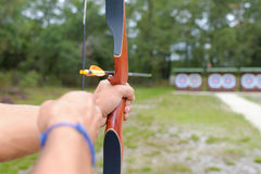 Closeup bow and arrow aiming towards target Royalty Free Stock Photos