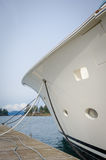 Bow of yacht moored at a dock in a harbor. Closeup of the bow of a yacht moored at a dock in a harbor on a sunny day Stock Photography