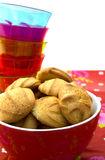 Closeup of a bowl with cookies and glasses Stock Images