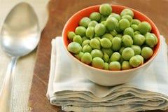 Closeup on bowl of fresh green peas Royalty Free Stock Image