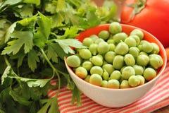 Closeup on bowl of fresh green peas Stock Image