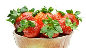 Closeup Bowl full of strawberries 360 degrees rotating looping isolated on white.  stock video