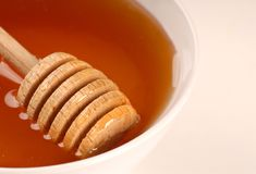 Closeup of a bowl of honey Stock Photo