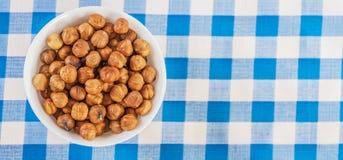 Closeup bowl many peeled hazelnuts Royalty Free Stock Photo