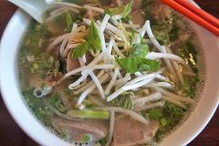 A bowl of hot pho soup stock photography