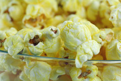 Closeup bowl of popcorn. Macro shot of a bowl of butter popcorn Royalty Free Stock Image