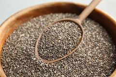 Closeup of bowl and spoon with chia. Seeds stock images