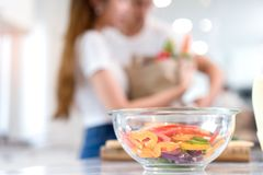 Closeup bowl, Young Asian man and woman couple together cutting slice vegetables stock photography