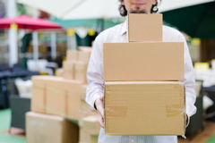 closeup on 3 boxes which man holding, carrying or moving in the store background Royalty Free Stock Photography