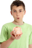 Closeup boy with money box. Close cropped shot of a boy with surpirse expression holding a money box Royalty Free Stock Photography