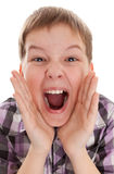 Closeup of a boy screaming out loud. Closeup portrait of a boy screaming out loud on a white background royalty free stock photography