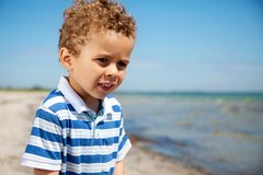 Closeup of a Boy on a Sunny Beach Royalty Free Stock Images