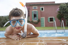 Closeup Of Boy Wearing Snorkeling Mask In Pool. Closeup portrait of a little boy wearing snorkeling mask in pool Stock Photos